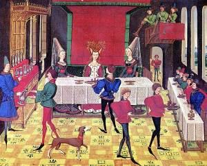 Banquet médiéval avec trois dames assises à une table.