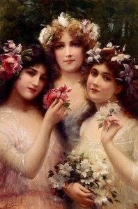 Dans ce tableau d'Émile Vernon (1872–1919), intitulé Les trois Grâces, on voit trois femmes, la tête ornée de fleurs.
